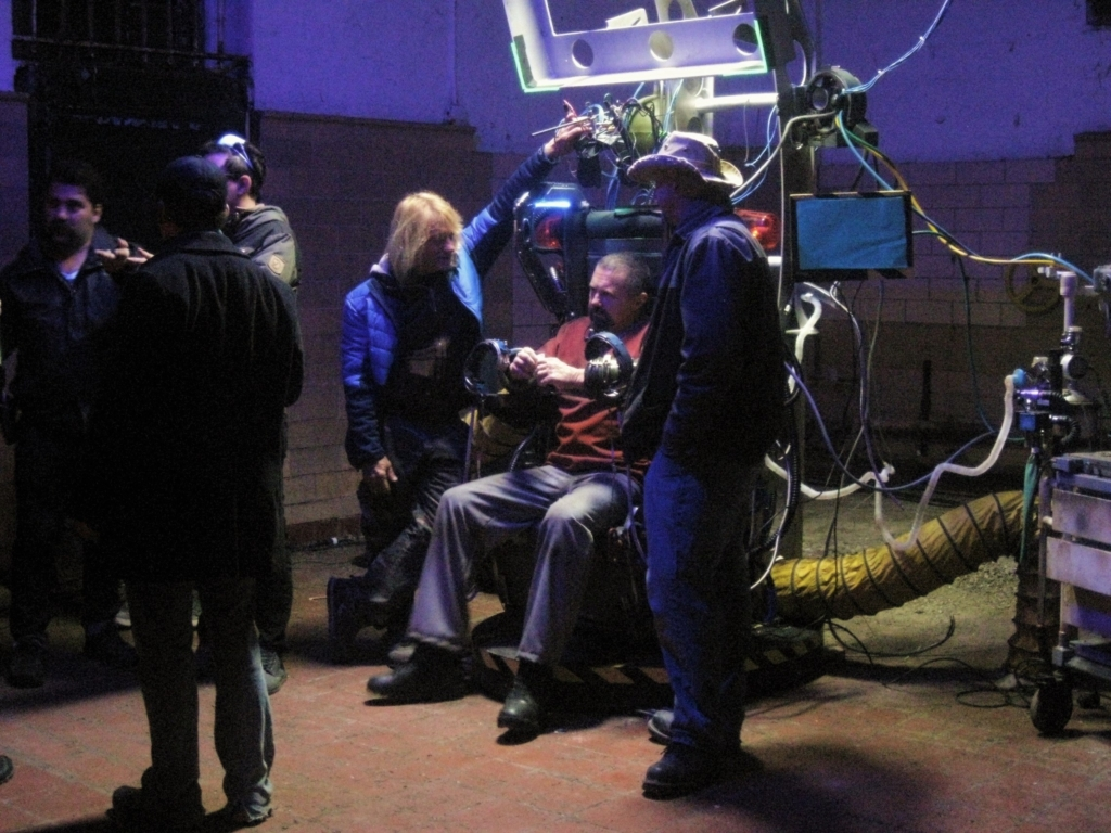 "Kane Hodder with George Giordano (Left) of PCND/fx and Matt Falleta (Right) of Sota FX who built ""the chair"", a monstrous and functional set piece with lights, wrist cuffs, and smoke."